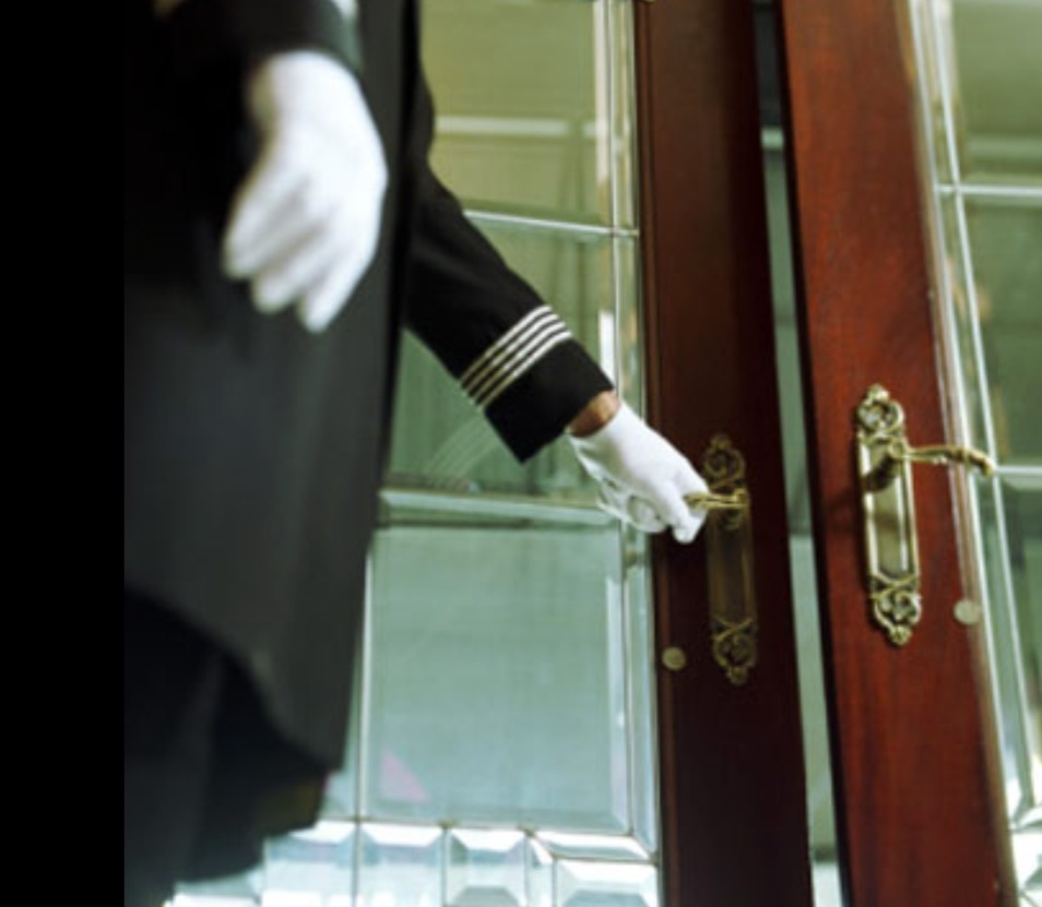 Whether walking through the lobby doors of a luxury apartment building or modest hotel doormen are often the first people you see upon arrival. & doorman.jpg